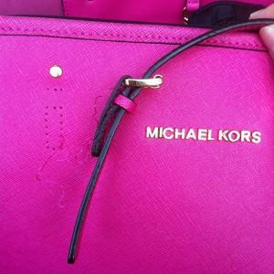 broken MK bag