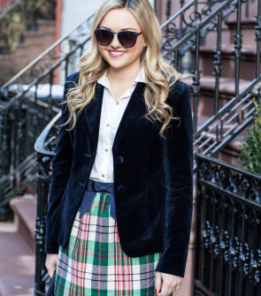 navy blue velvet blazer with white button front shirt and plaid skirt