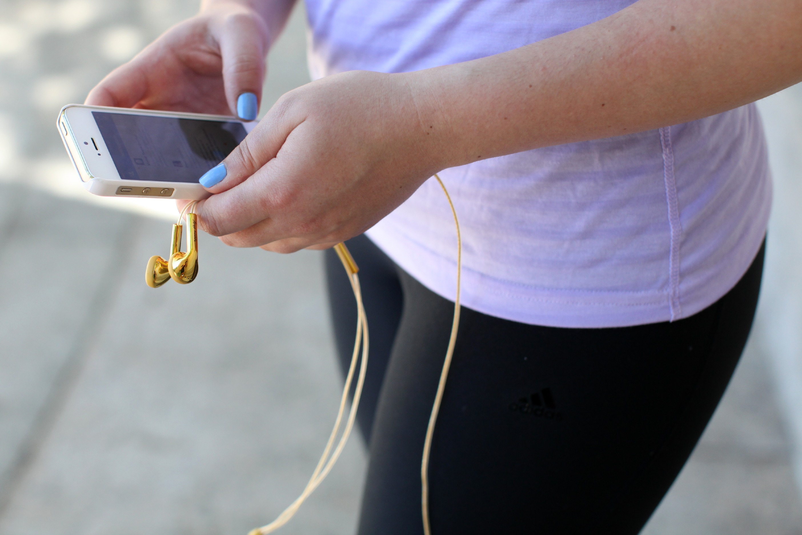 Gold Headphones with Apple iPhone