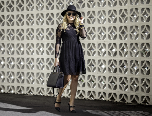 black lace dress with pointed pumps and black hat