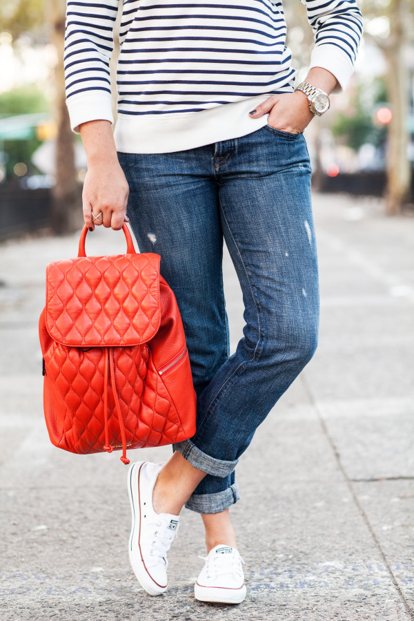 navy white striped sweatshirt boyfriend jeans converse sneakers orange leather quilted backpack