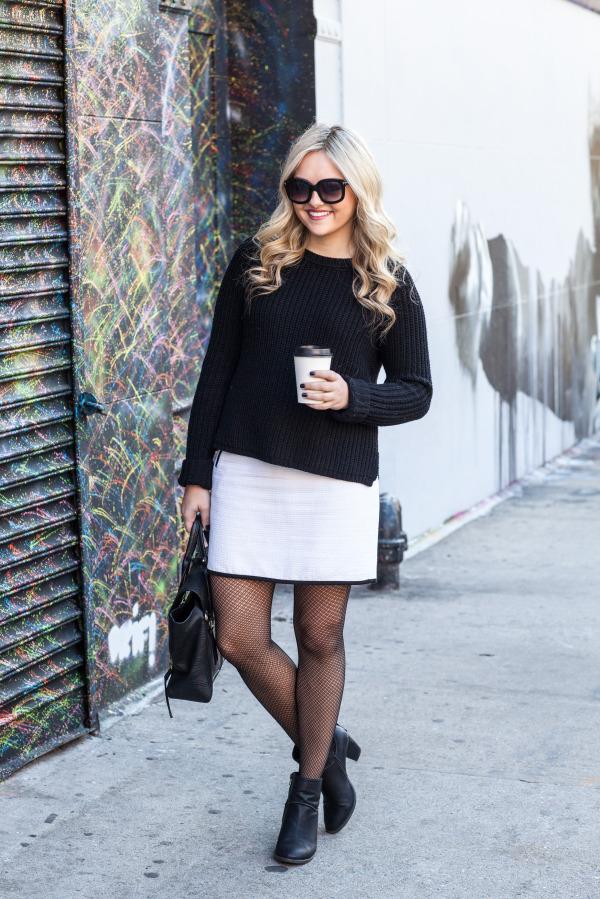 black sweater white skirt black booties crochet textured tights