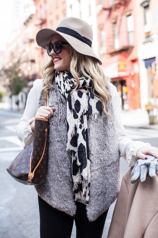 chic travel outfit hat scarf fur vest