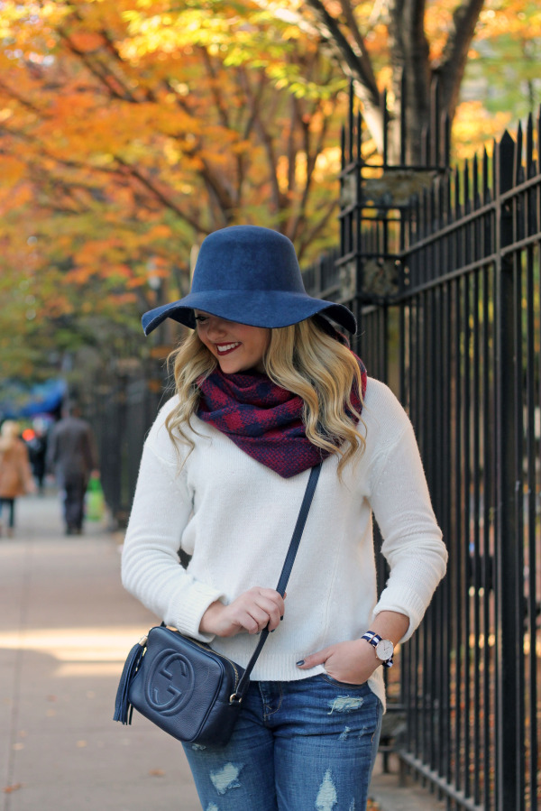 fall outfit hat, blanket scarf, white sweater, ripped jeans