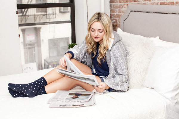 reading the newspaper in bed pjs