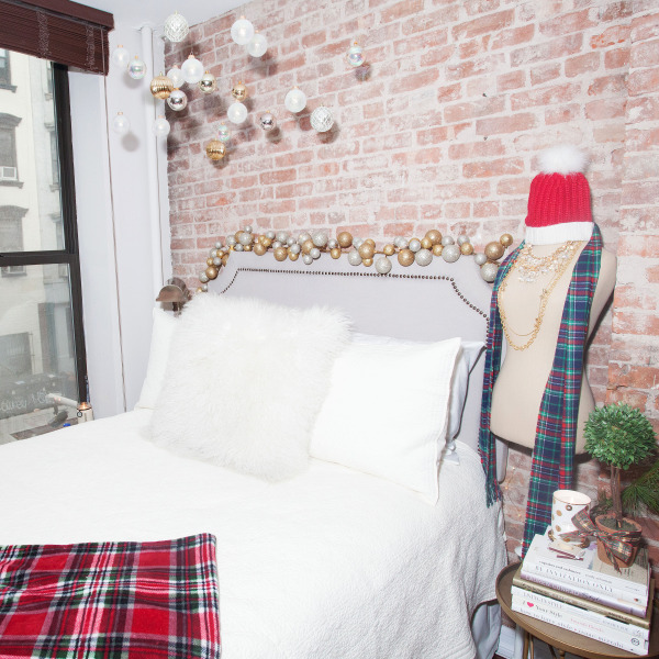 nailhead-headboard,-plaid-blanket,-west-elm-pillow,-restoration-hardware-bedding