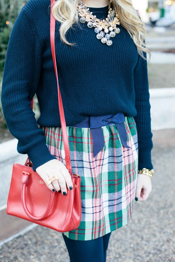 plaid skirt outfit navy sweater red crossbody bag