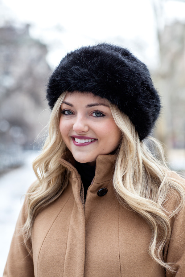 black faux fur hat camel wool coat