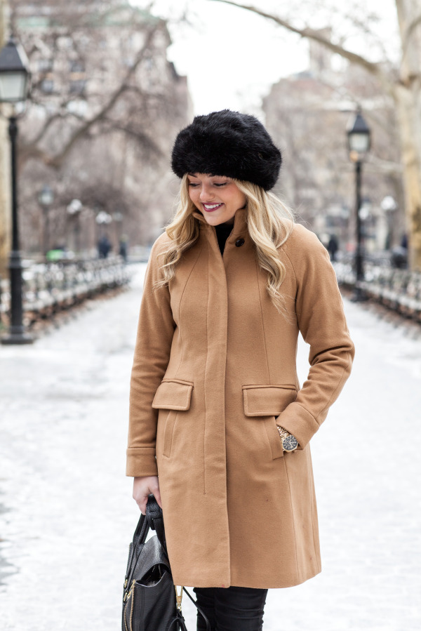black fur hat, camel coat