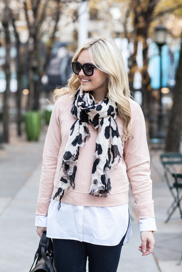 Style blogger Bows & Sequins wearing a blush pink sweater, leopard scarf, and sunglasses.