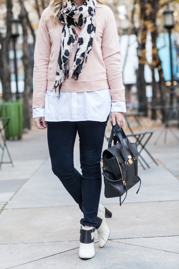 long white shirt layered under sweatshirt