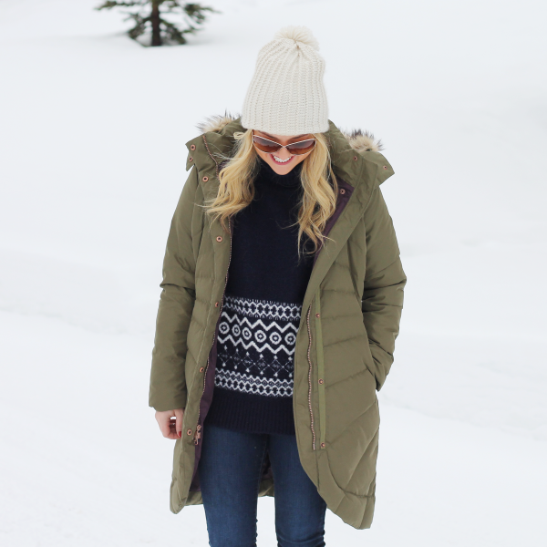 pom pom beanie, fair isle sweater, jeans, puffer coat winter outfit