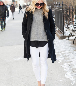 black coat with white jeans