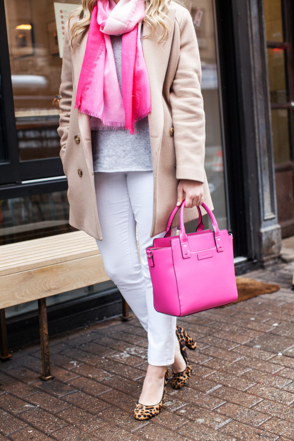 Bows & Sequins styling a camel coat, gray sweater, white denim, pink ombre scarf, leopard pumps, and a hot pink handbag.