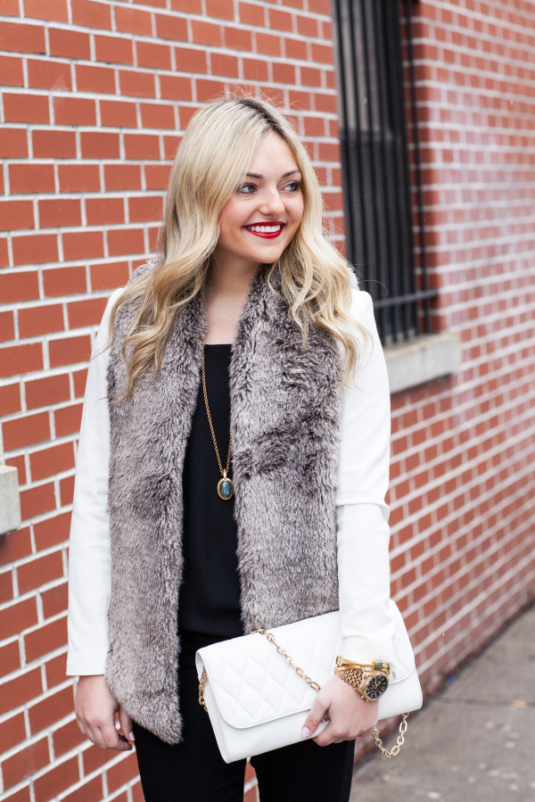 outfit fur vest over a white blazer