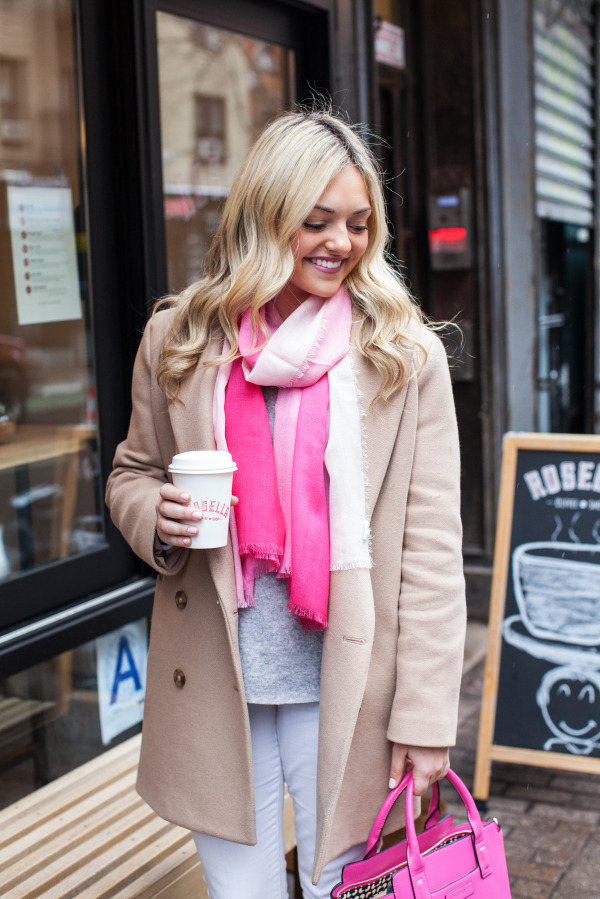 pink scarf with camel coat