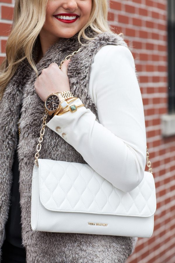 white leather clutch with strap