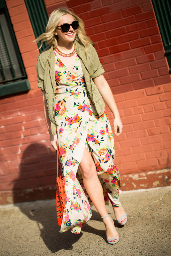 army jacket over a floral maxi dress
