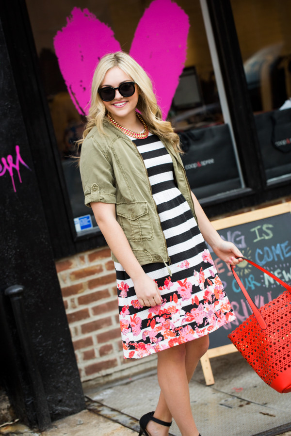 army jacket over striped dress