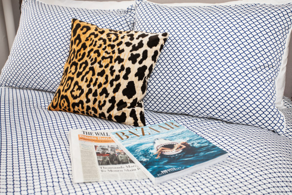 blue and white bedding with leopard pillow