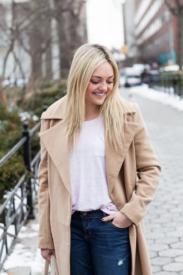 blush pink top and camel coat