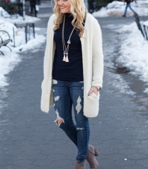boho outfit - tassetl necklaces, turtleneck, cardigan, ripped jeans, booties