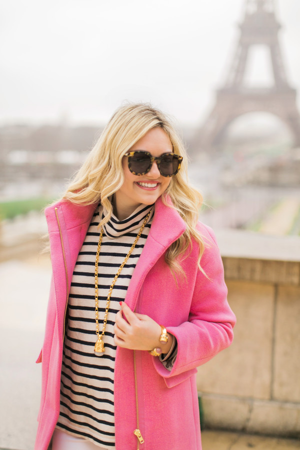 pink coat with striped turtleneck