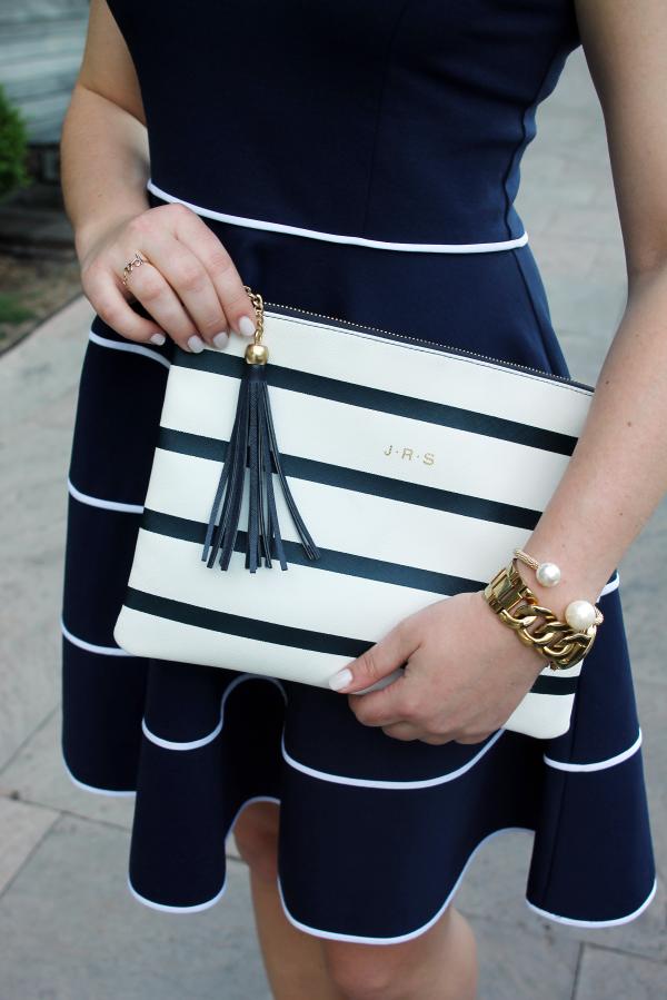 striped-tassel-monogram-clutch