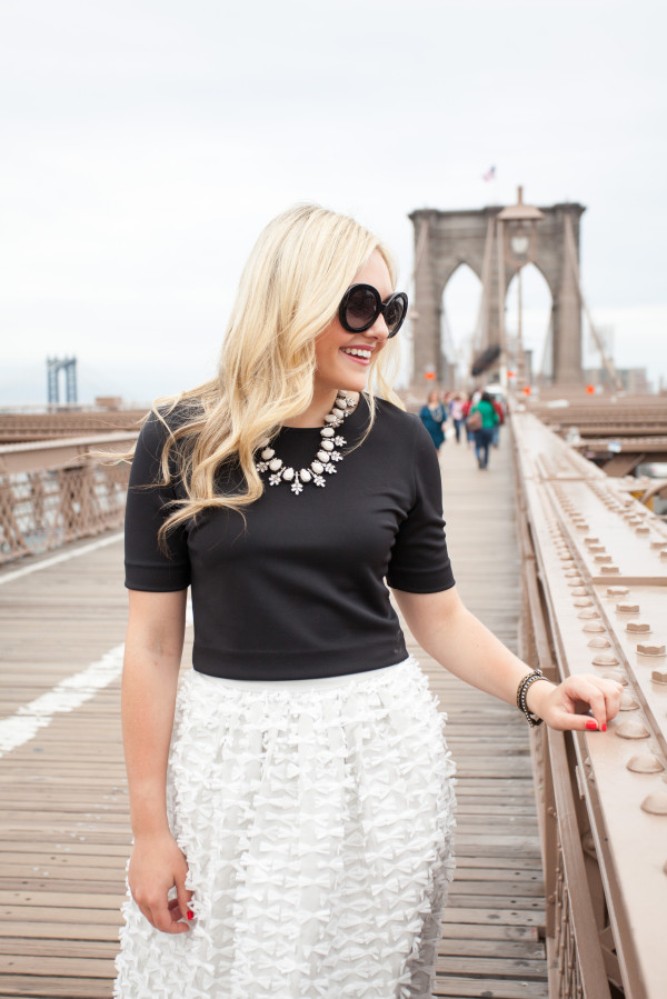 brooklyn bridge, nyc -- prada sunglasses - black crop top - tibi bow skirt - bauble bar statement necklace - blogger