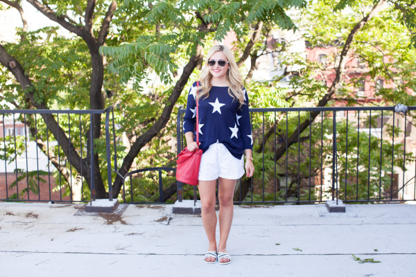 july 4th rooftop nyc star sweater, red bucket bag, white linen shorts, striped sandals