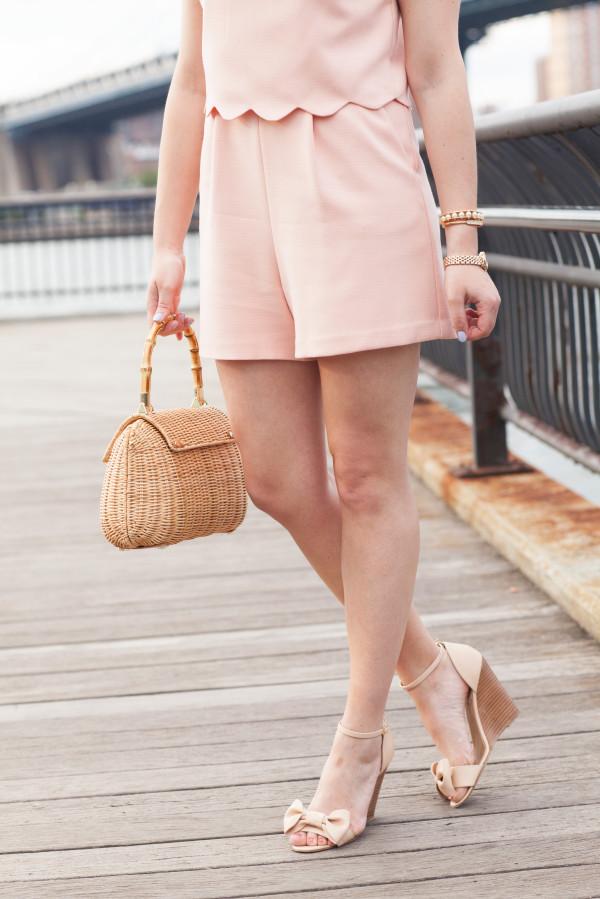 nude bow wedges, peach scalloped shorts, wicker handbag