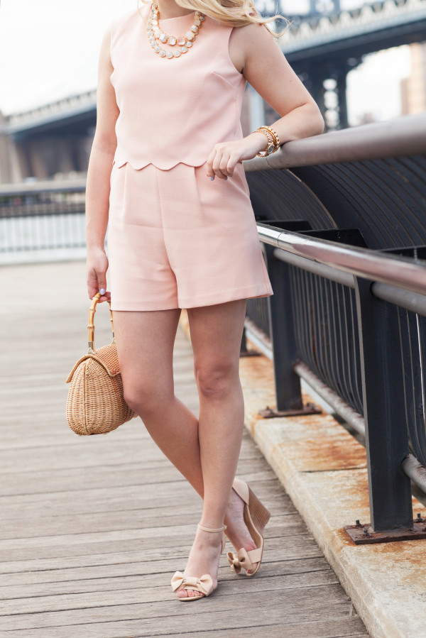 peach romper with scallops, red valentino bow wedges, wicker handbag with bamboo