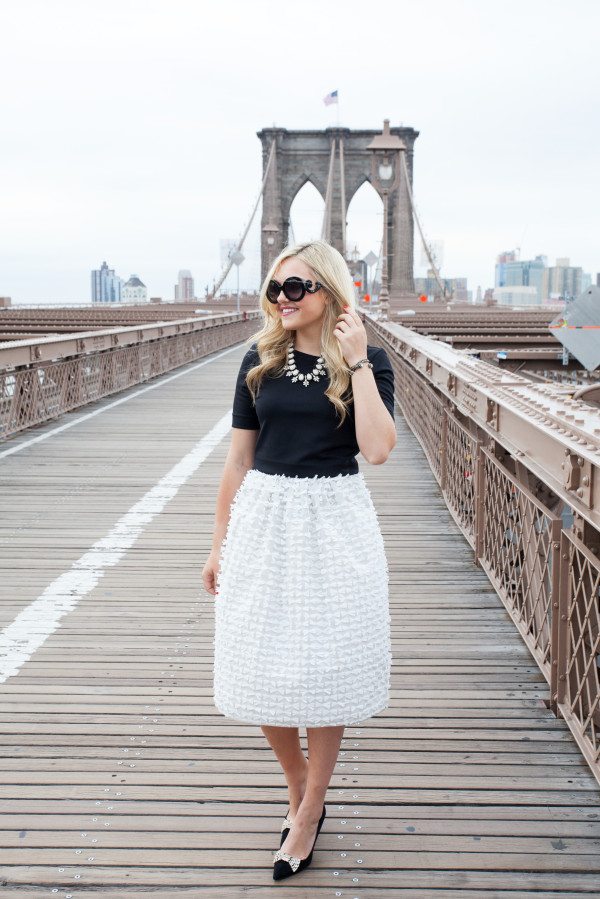 prada baroque sunglasses - bauble bar necklace - tibi bow skirt - kate spade bow heels - brooklyn bridge nyc - fashion blogger outfit