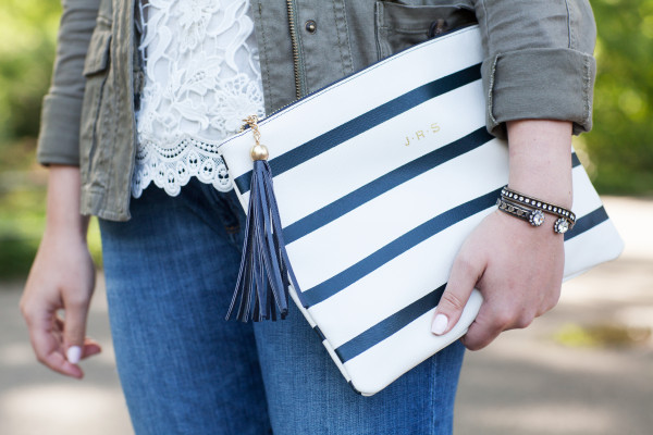 white and navy striped clutch with tassel