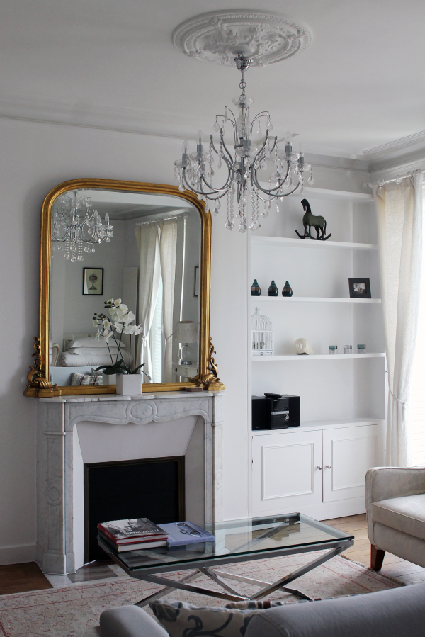 white-marble-fireplace-gold-mirror-chandellier-paris-home-decor-inspiration