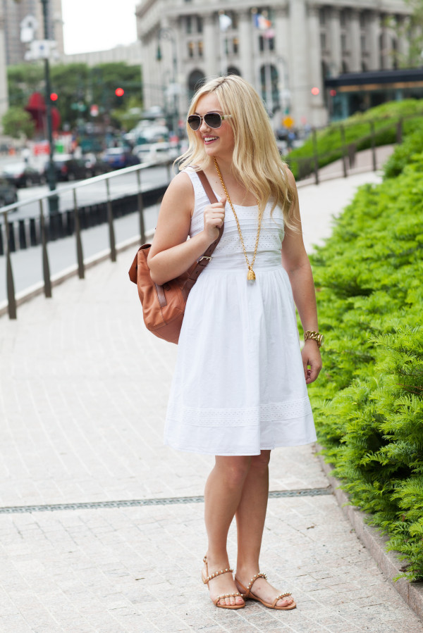 white summer dress with leather back pack