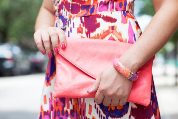 coral clutch, sequin bangle, ikat dress
