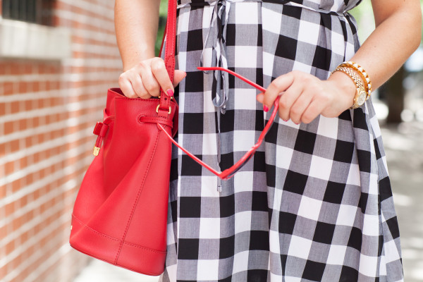 gingham dress with red accessories