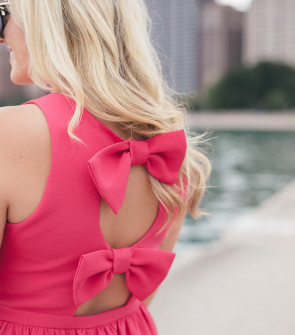 Bows & Sequins wearing a pink bow back dress in Chicago.