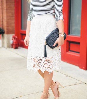 Bows & Sequins wearing a striped tee and a long lace skirt.