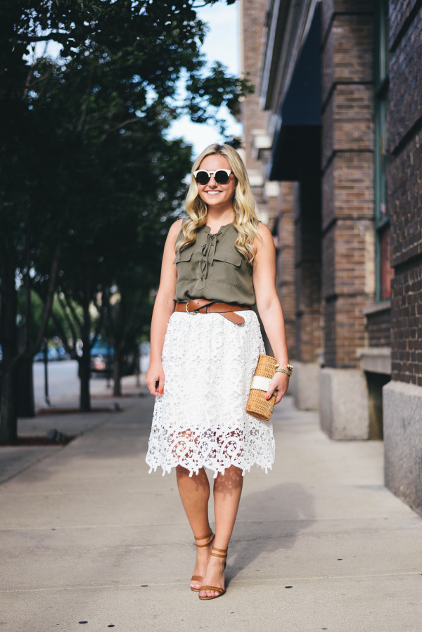 green blouse, white lace skirt, leather belt and sandals
