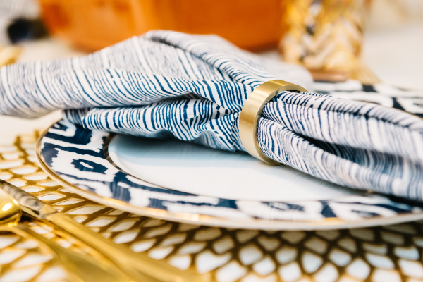 blue-and-white-napkins-brass-napkin-ring
