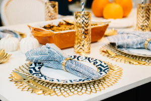 thanksgiving tablescape navy and orange and gold