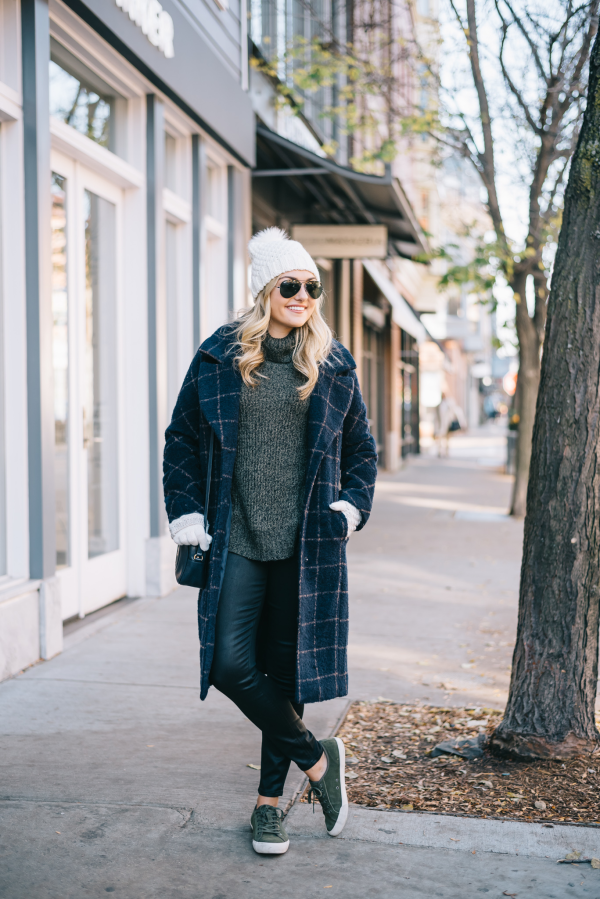 Bows & Sequins styling a plaid coat, turtleneck sweater, waxed jeans, and suede sneakers for winter.