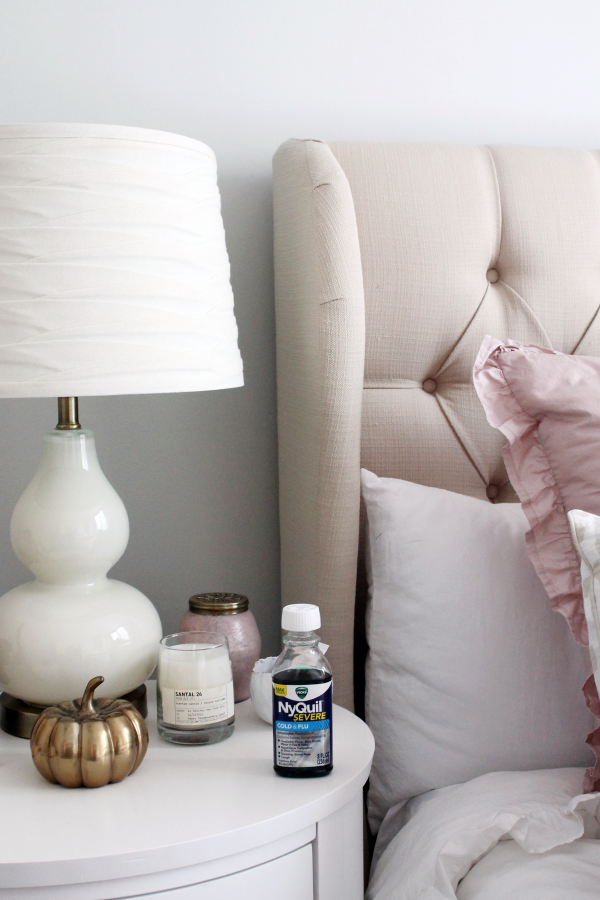 tufted headboard, ruffled duvet cover, white gourd glass lamp