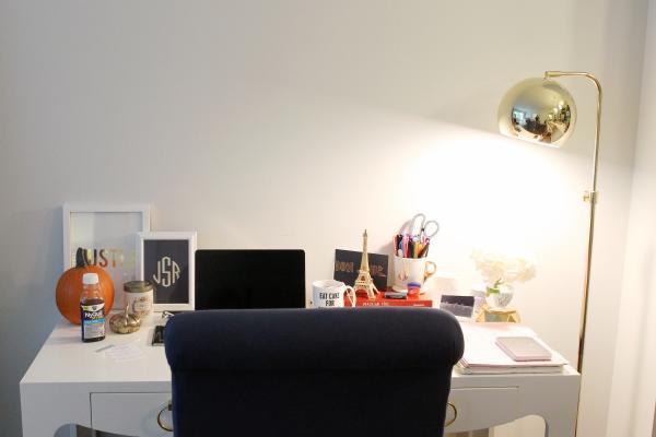 white desk, navy chair, gold floor lamp