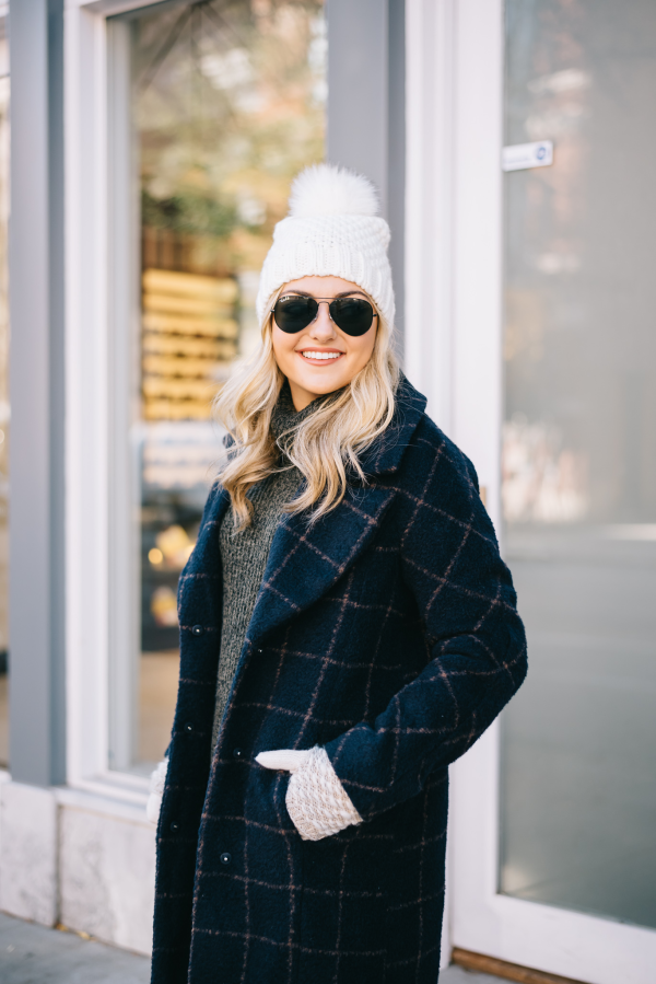 white pom pom winter hat