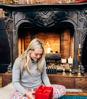 christmas morning pajamas in front of fireplace