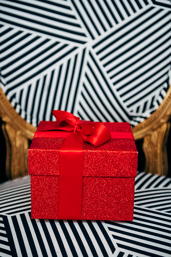 red glitter present gift box with a bow