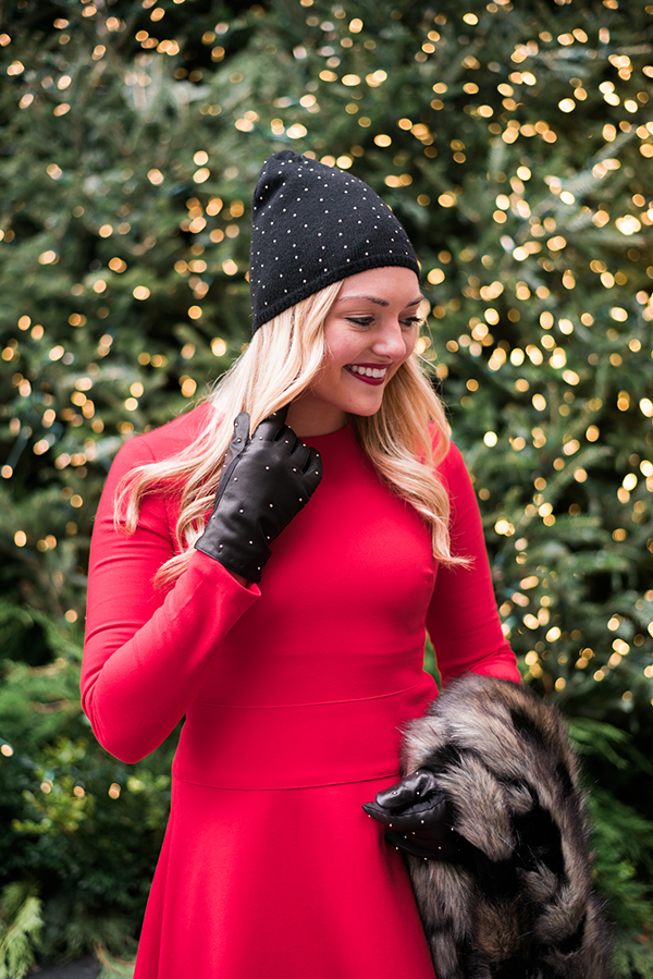 red holiday dress black and gold beanie and leather gloves